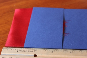 Lay the pocket square so that it is just about one inch above the card