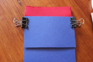 Use the binder clips to hold the pieces together the silk is very slippery and this works really well